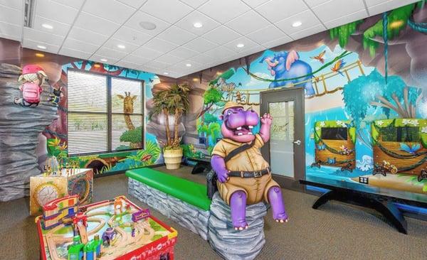 hippo adventurer with jungle murals