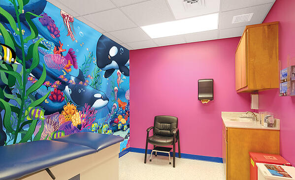 medical clinic exam room with ocean mural