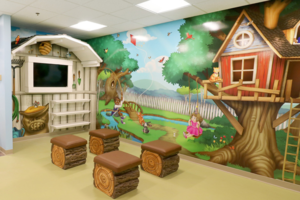 theater for children with backyard mural